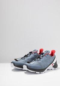 Salomon - SUPERCROSS GTX - Trail running shoes - flint stone/black/high risk red - 2