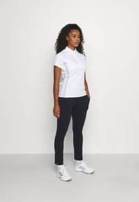 J.LINDEBERG - LEA PULL ON  - Trousers - navy - 1