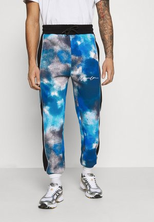 TIE DYE UNISEX - Tracksuit bottoms - blue
