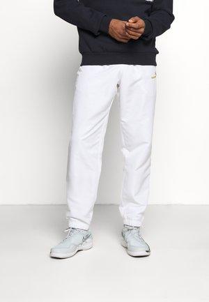 CARSON PANTS - Pantalon de survêtement - white/gold