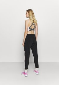 Fila - LACI PANTS - Tracksuit bottoms - black - 2