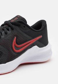 Nike Performance - DOWNSHIFTER 11 UNISEX - Neutral running shoes - black/universe red/dark smoke grey/white - 5