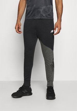 VELOCITY JOGGER - Tracksuit bottoms - black