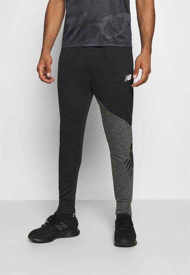 VELOCITY JOGGER - Teplákové kalhoty - black