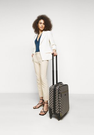 RANIERO - Wheeled suitcase - black