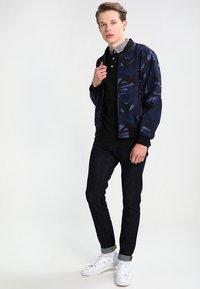 Carhartt WIP - REBEL PANT SPICER - Slim fit jeans - blue one wash - 1