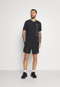 Nike Performance - MILER HYBRID - Print T-shirt - black/silver - 1