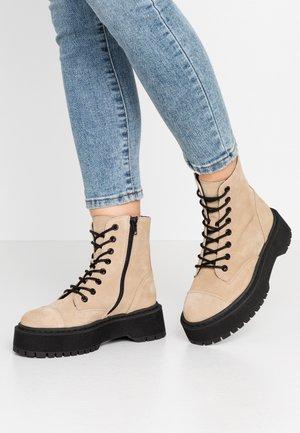 VMPATH BOOT - Platform ankle boots - beige