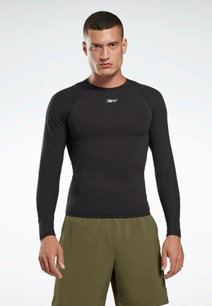 UNITED BY FITNESS - Sports shirt - black