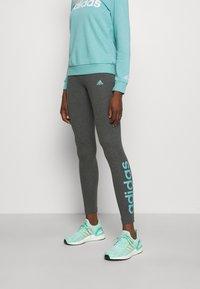 adidas Performance - LOUNGEWEAR ESSENTIALS HIGH-WAISTED LOGO LEGGINGS - Tights - dark grey heather/mint ton - 2