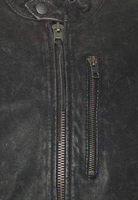 Tigha - STIGO - Leather jacket - black stone wash - 2