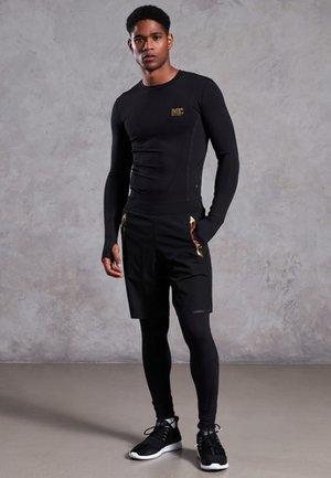 PERFORMANCE KOMPRESSIONS-LEGGINGS - Leggings - black