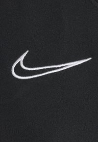 Nike Performance - T-shirt z nadrukiem - black/white