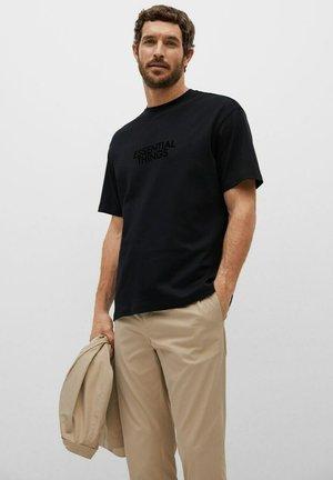 RELAXED FIT - Print T-shirt - noir