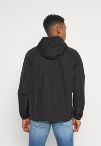 Champion Reverse Weave - HOODED JACKET - Větrovka - black - 2