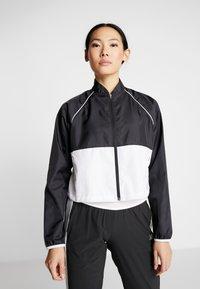 New Balance - VELOCITY JACKET - Sports jacket - black/white - 0
