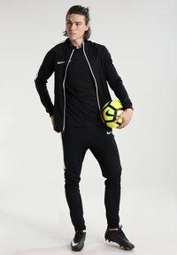 Nike Performance - DRY TRACKSUIT ACADEMY - Tracksuit - black/white - 1