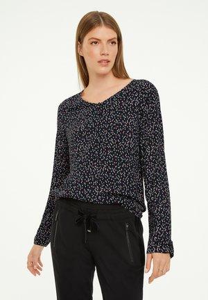 Long sleeved top - black drops minimal