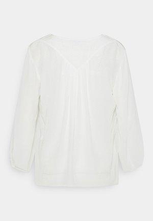 Blusa - off white
