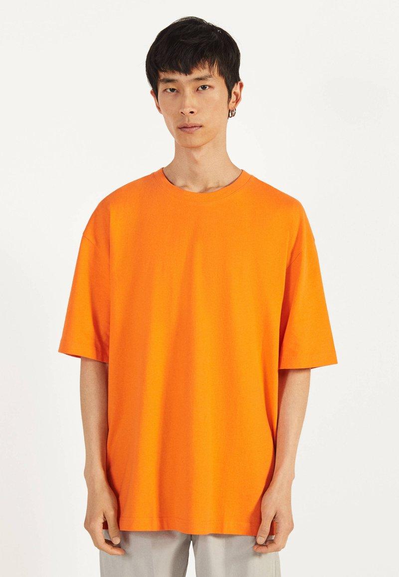 Bershka - Basic T-shirt - orange