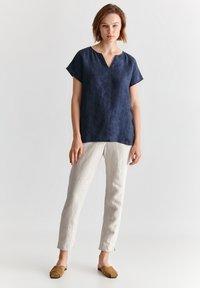 TATUUM - JUKI  - Trousers - beige melange - 1