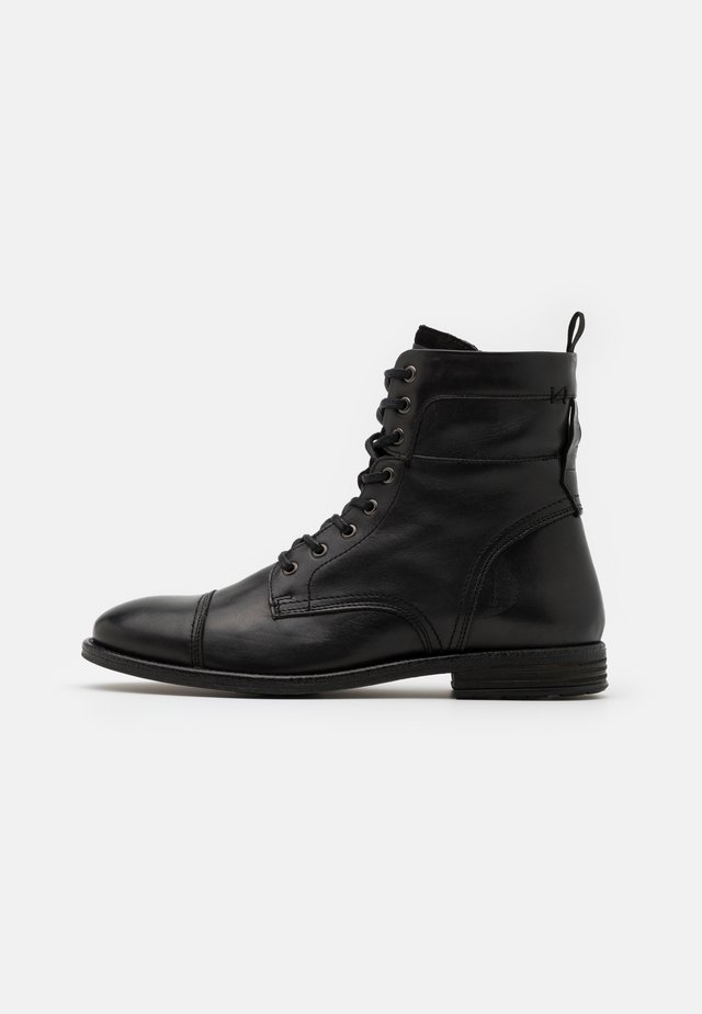 NEVADO - Lace-up ankle boots - black