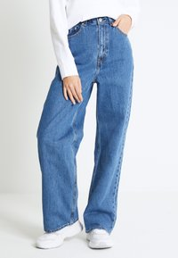 Levi's® - HIGH LOOSE - Flared Jeans - blue denim - 0