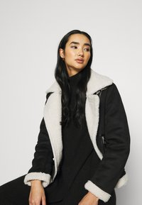 ONLY - ONLDIANA BONDED AVIATOR JACKET - Faux leather jacket - black/white - 4