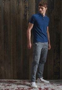 Superdry - Polo shirt - dark blue - 0