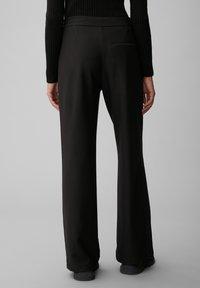 Marc O'Polo - Trousers - black - 1