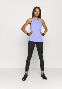 Nike Performance - TANK ALL OVER  - Camiseta de deporte - light thistle/white - 1