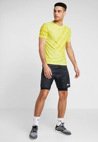 Nike Performance - TECH COOL  - Print T-shirt - volt/dark sulfur/reflective silver - 1