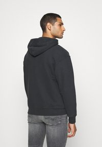 Levi's® - RELAXED GRAPHIC ZIPUP - Zip-up hoodie - jet black - 2