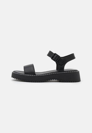 HARIS - Sandalias con plataforma - black