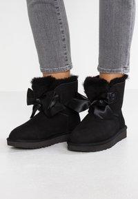 UGG - GITA BOW MINI - Classic ankle boots - black - 0
