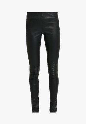 DELTA  - Leggings - Trousers - black