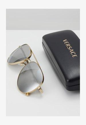 Sluneční brýle - pale gold-coloured