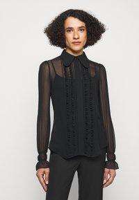 Victoria Beckham - FRILL DETAIL BLOUSE - Button-down blouse - black - 0