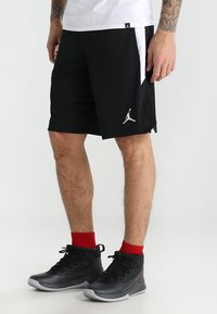 Jordan - ALPHA DRY - Sports shorts - black/white/white - 0
