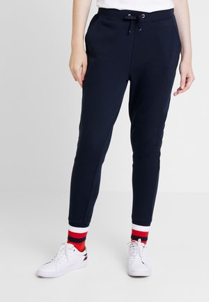 HERITAGE PANTS - Verryttelyhousut - midnight