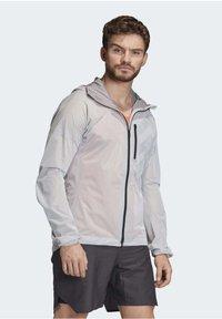 adidas Performance - TERREX AGRAVIC RAIN JACKET - Sports jacket - white - 5