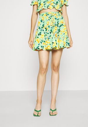 HIGH WAISTED TIERED MINI SKIRT WITH FRONT TIE DETAIL - Minihame - green