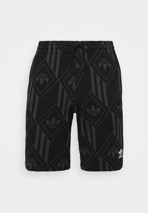 MONO  - Tracksuit bottoms - black