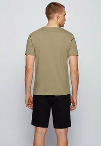 BOSS - TEE CURVED - Basic T-shirt - dark green - 2