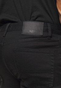 Superdry - 02 TRAVIS SKINNY NEW CODE NOS - Jeans Skinny Fit - berkeley black - 5