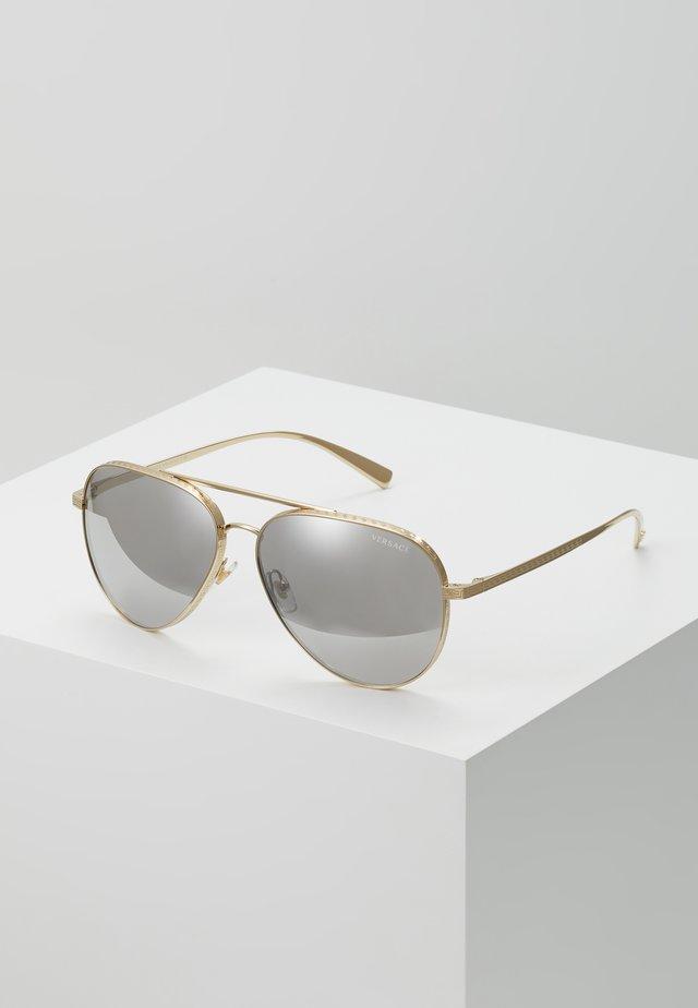 Solbriller - pale gold-coloured