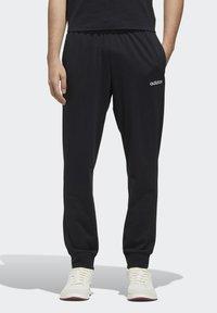 adidas Performance - ESSENTIALS JOGGER JOGGERS - Pantaloni sportivi - black - 0