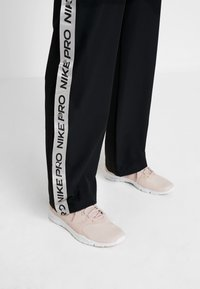Nike Performance - CAPSULE TEAR AWAY PANT - Tracksuit bottoms - black/metallic silver - 4