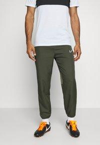 Nike Performance - DRY ACADEMY PANT - Tracksuit bottoms - cargo khaki/medium olive/white - 0