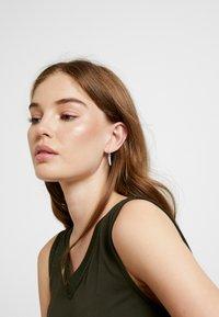 Swarovski - POLAR BESTIARY MINI HOOP TEETH - Earrings - silver-coloured - 1